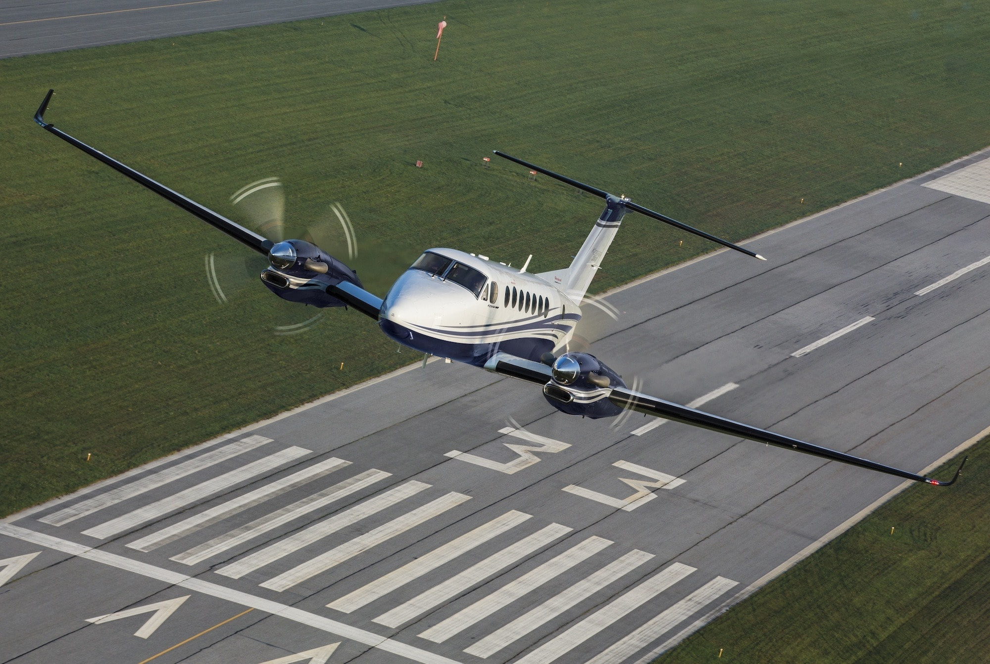 Beechcraft King Air 360 Exterior takeoff from runway