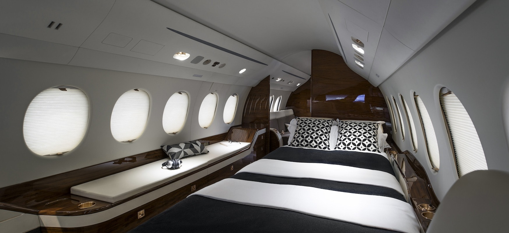 Bed interior on a Dassault Falcon 7X - private jet vs first class
