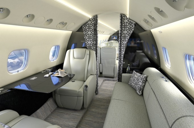 Embraer Legacy 650E divan looking to front of cabin