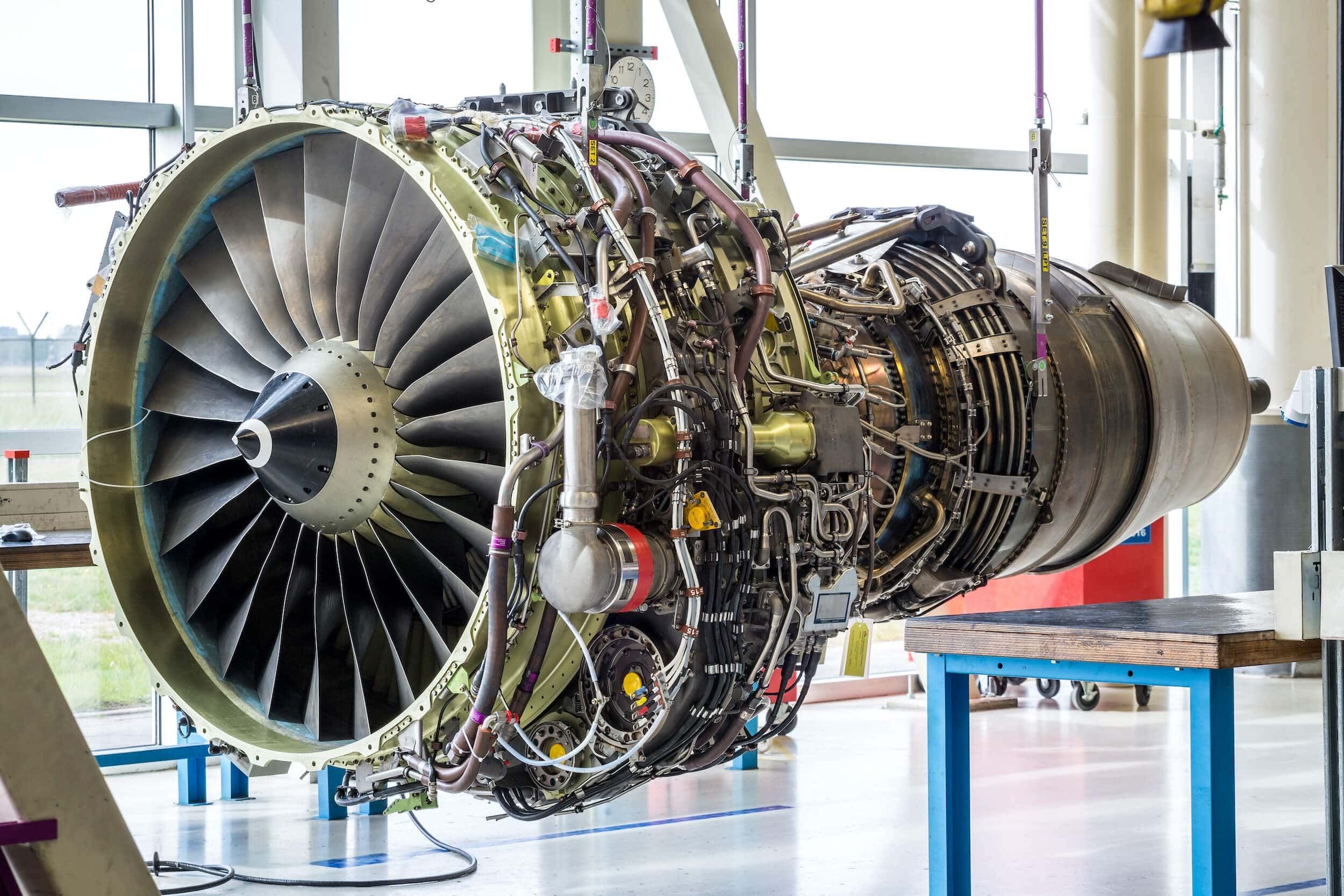 Jet Engine being Maintained in Hangar - Honeywell engines